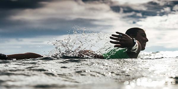 Founder and yoga retreat facilitator Alex Ruiz surfing
